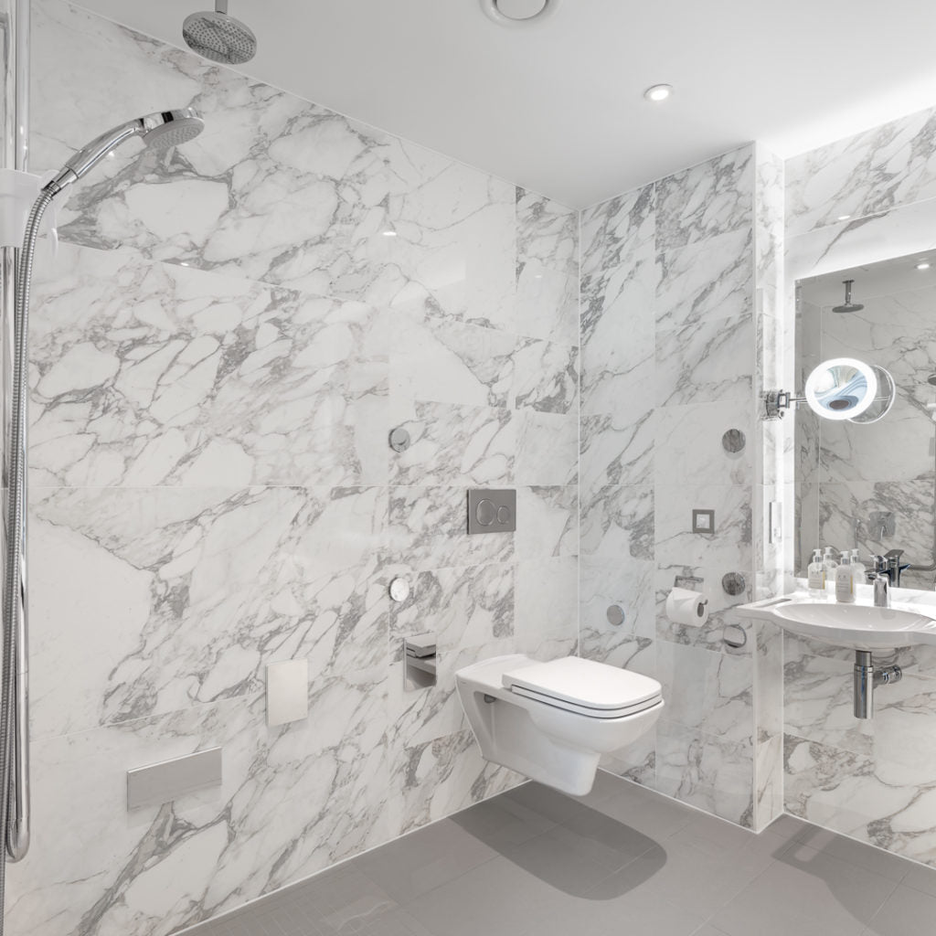 Removable grab rails and shower seat in The Tamburlaine hotel
