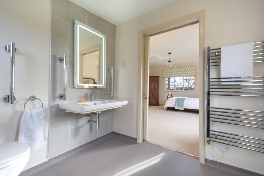 The Old Club House's accessible bathroom with mirror and sink