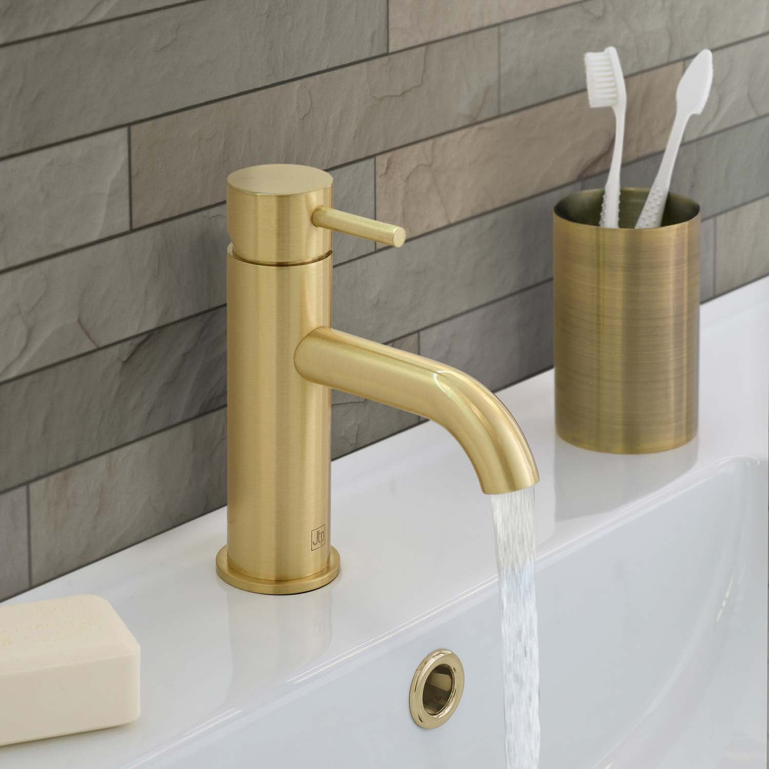 One hole deck mounted Libero Lever Basin Tap with a brushed brass finish lifestyle image
