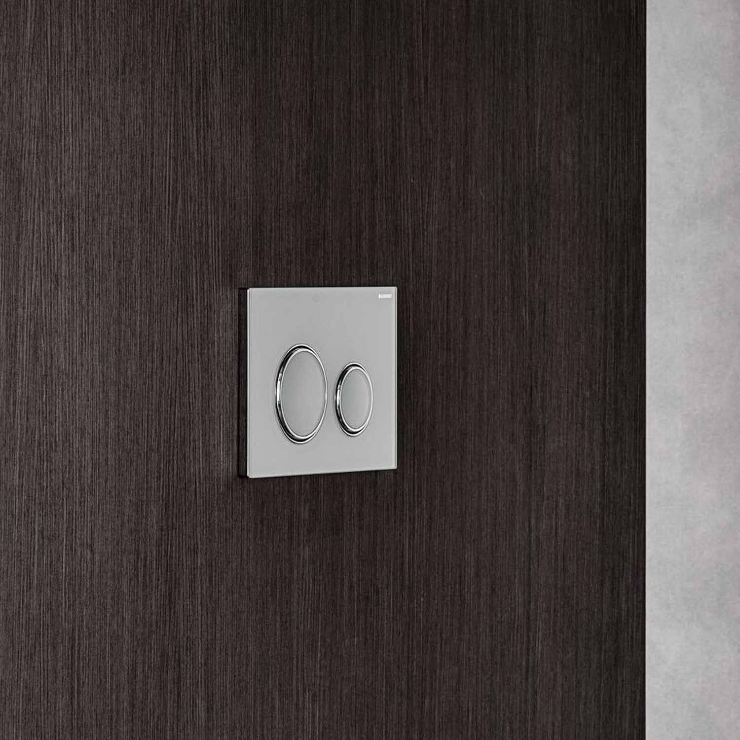 Sigma Round Dual Action Flush Plate with a white and chrome finish lifestyle image