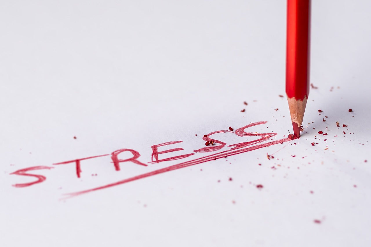 red pencil writing stress