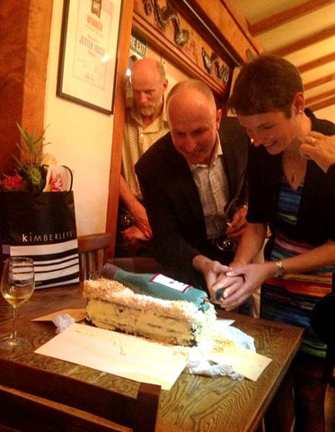 Daniel and Ursula cutting Birthday Cake at award-winning Jester House in Tasman