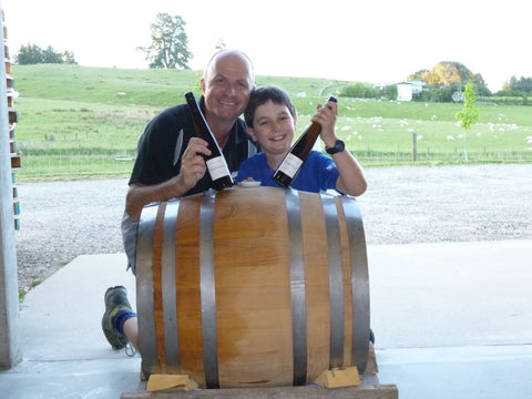 Daniel and Thomas Schwarzenbach with acacia barrel of dessert Riesling