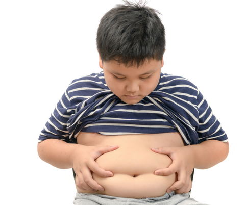 A child holds his tummy fat