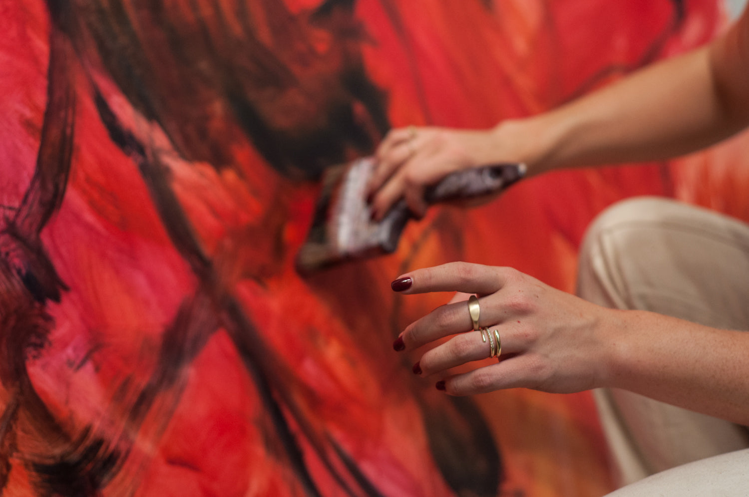 Caroline Eleanor Absher painting in her studio for Made Line Work is Love Made Visible Campaign.