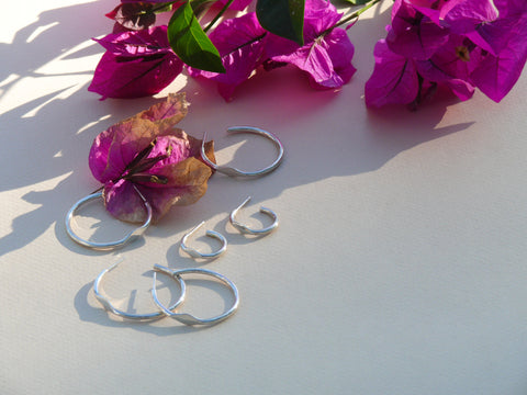 silver signet hoops with flowers and shadows