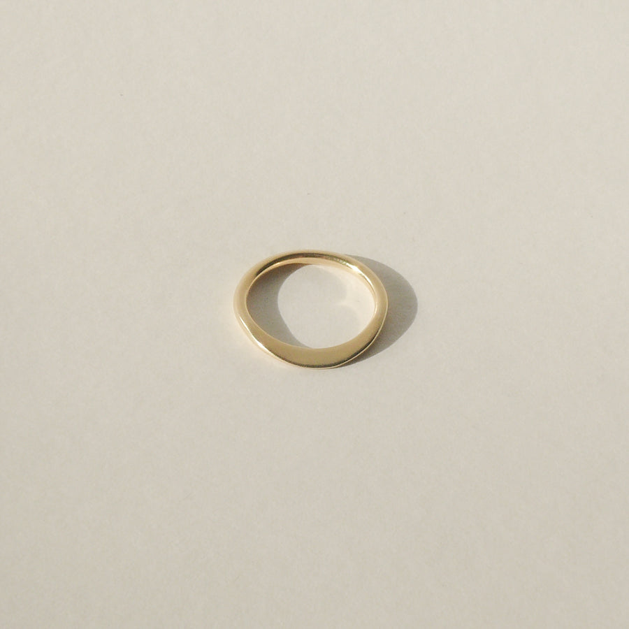 gold petite ridge ring on white with shadow
