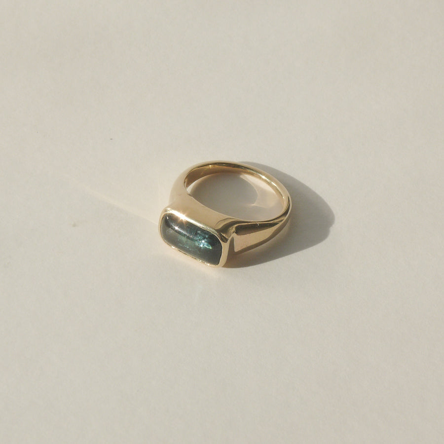 gold green tourmaline fortress signet ring on white with shadow