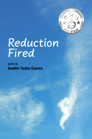 """A book cover.  A photograph of a blue sky with a white cloud in the shape of a dragon in the lower right.  The title in the upper left reads, """"Reduction Fired - poetry of Jennifer Yeates Camara"""".  There is a round silver sticker in the upper right reading """"Reader's Favorite 5 Stars"""""""