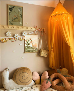 Childs room with Wildlings prints, featuring snails and mushrooms