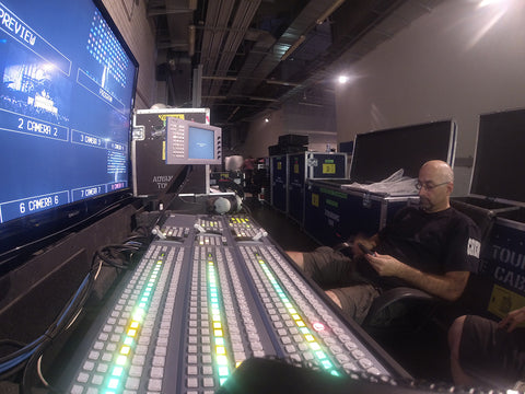 Tim Brennan sitting in front of a Sony MVS 6000 Vision mixing desk on Rhianna's Diamonds tour