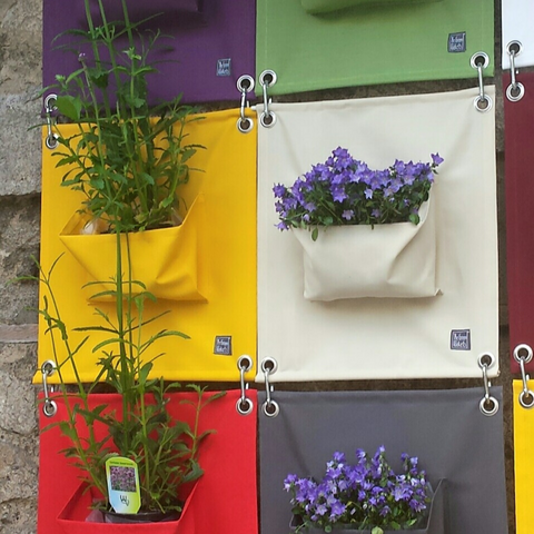multi-coloured wall hanging with plants
