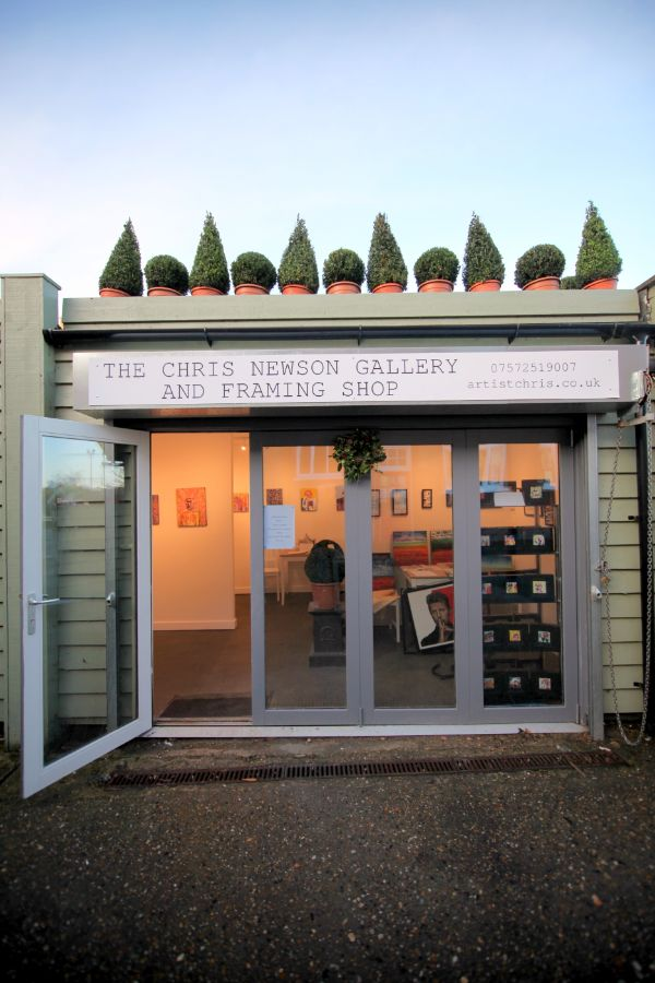 outside looking in to Chris Newson's art gallery and framing shop