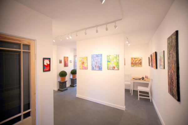 inside Chris Newson's art gallery and framing shop