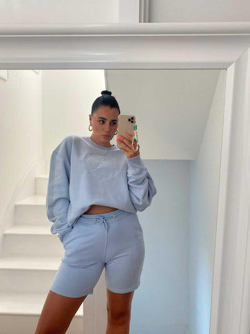 Grace wearing This Is Anyo blue set