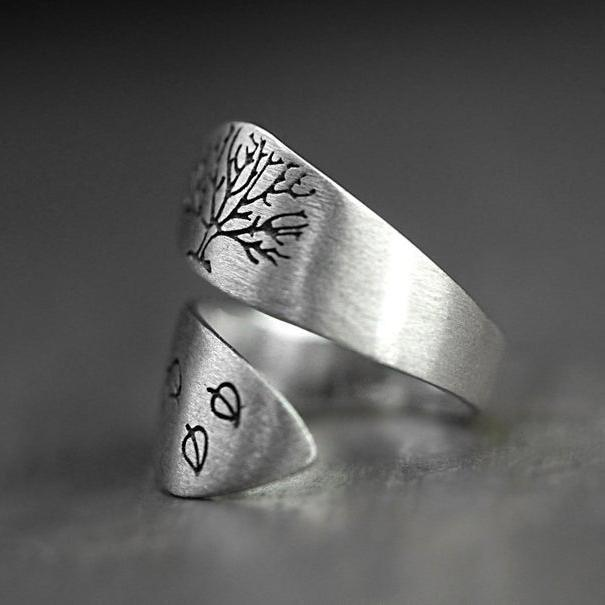 Hand stamped sterling dandelion ring. Wrap around ring, handstamped with dandelion and dandelion seeds. Adjustable.