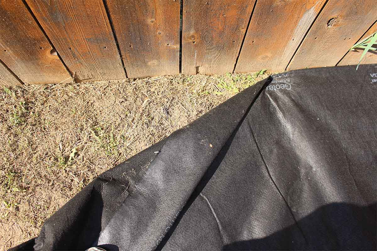 fold the geo-fabric under when installing along the edge
