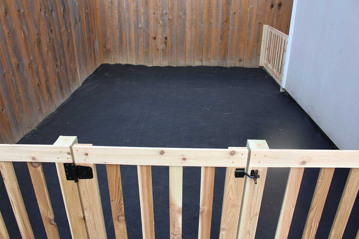 install weed barrier or geo fabric under the raised garden beds