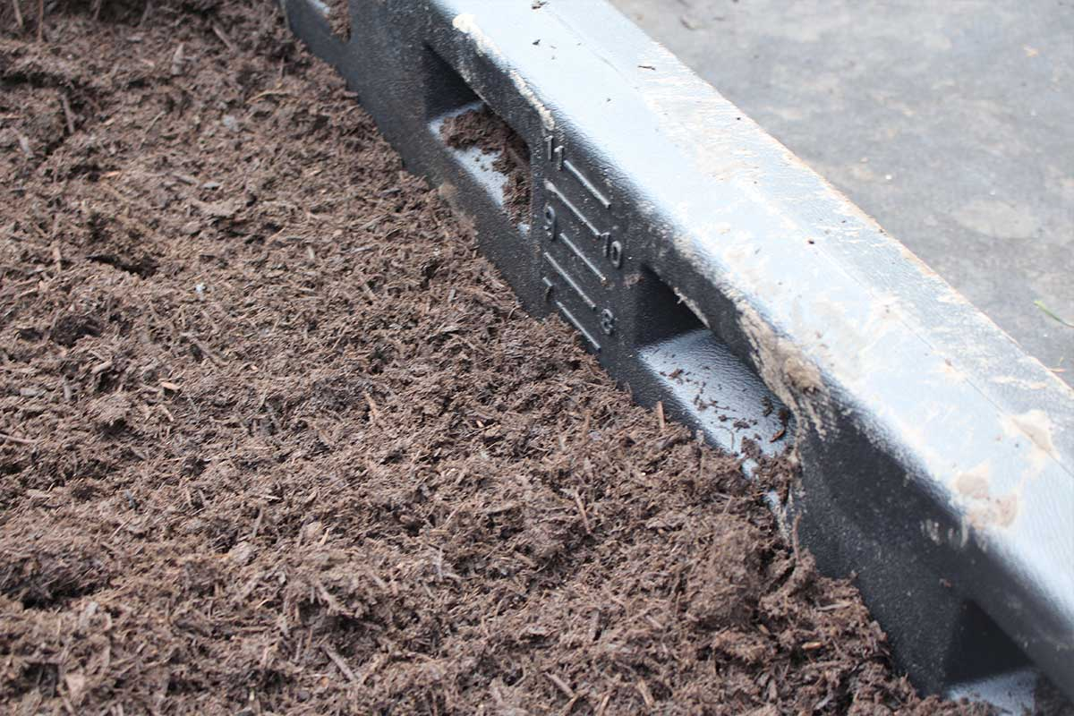 the playground borders have a surfacing guide for that is a big help with mixing soil