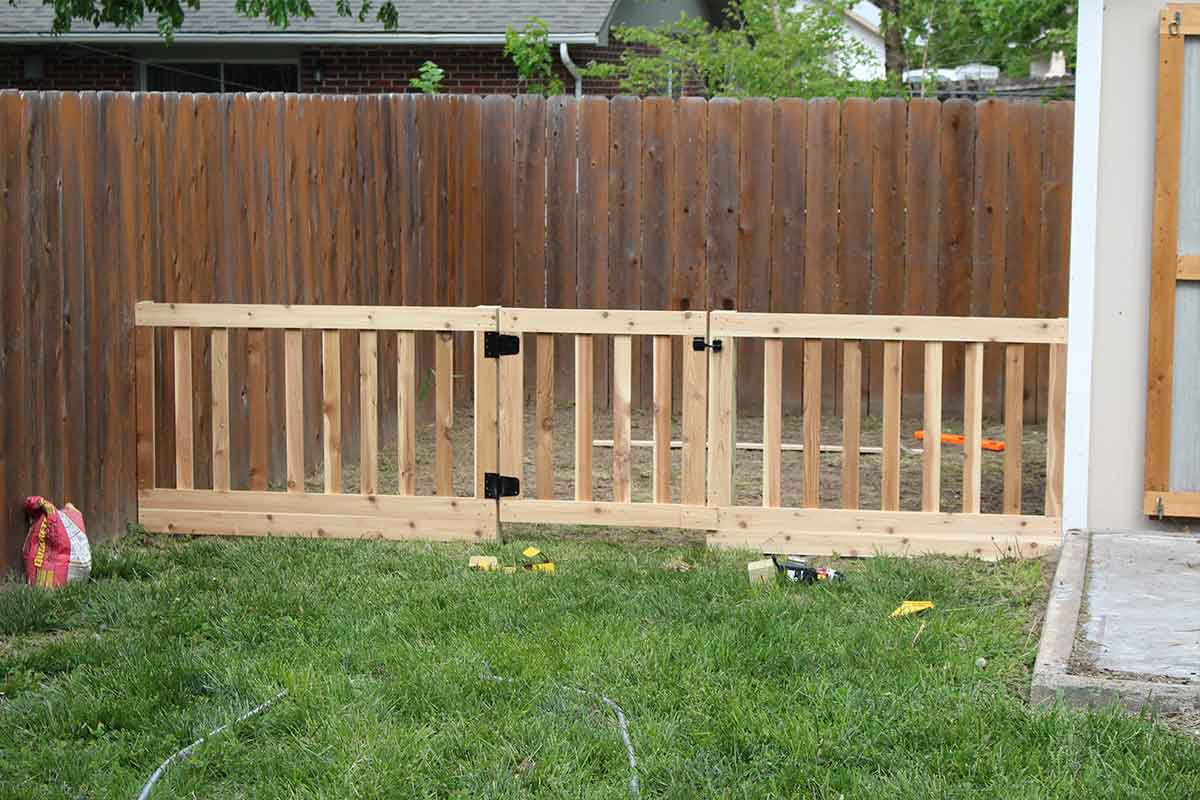 build a fence around the raised beds to keep critters away