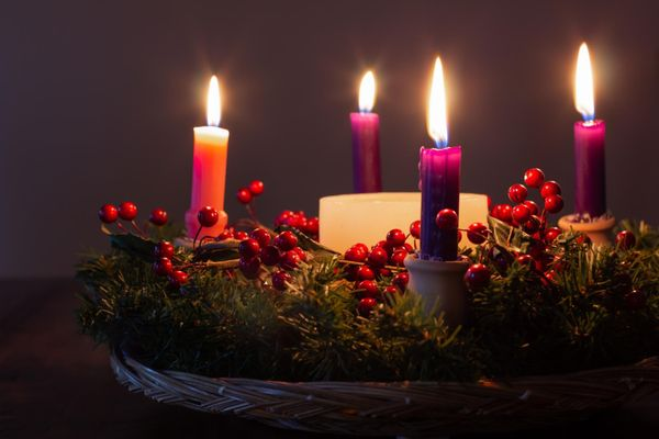 Moody advent wreath with all candles lit