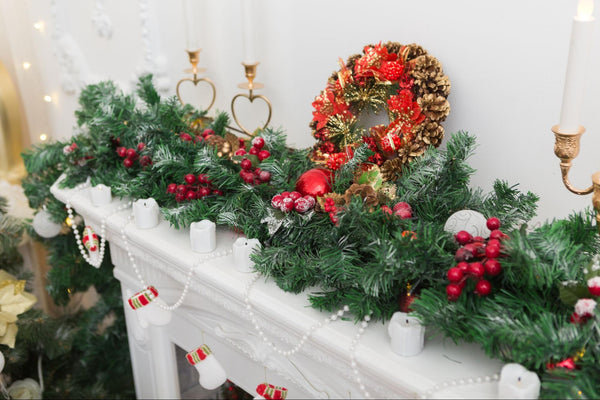 Fireplace decorated with fresh greenery and Christmas wreath