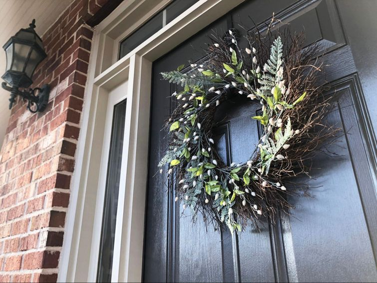 Christmas wreath hung up on front doo