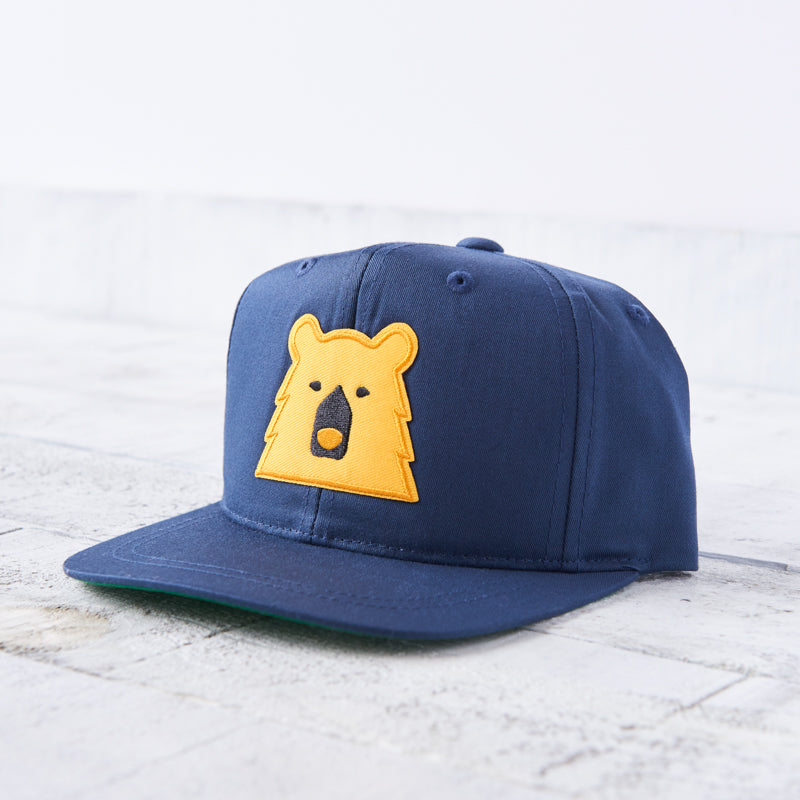 NSTP Youth Snapback - Navy with Golden Yellow Bear