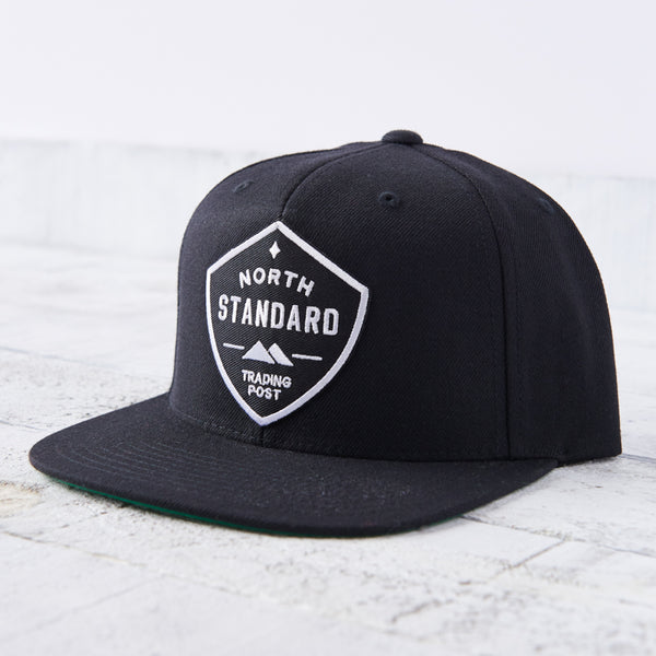 NSTP Snapback - Black with Black/White Shield