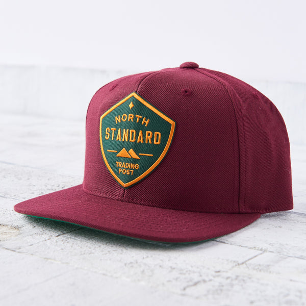 NSTP Snapback - Maroon with Spruce/Gold Shield