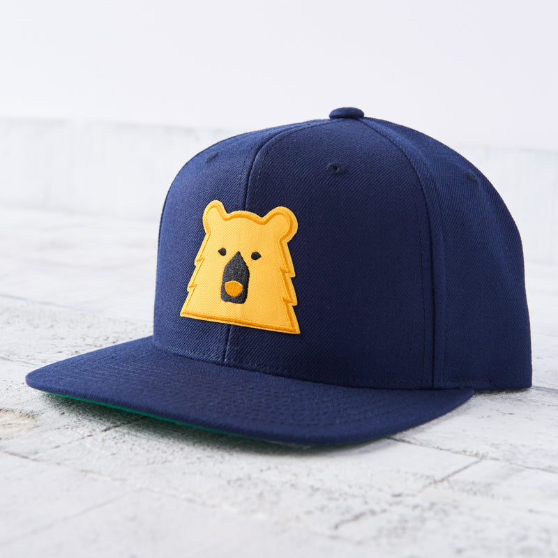 NSTP Snapback - Navy with Golden Yellow Bear