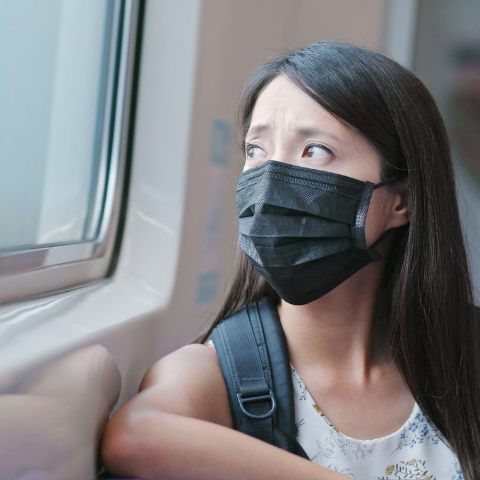 A girl wearing a mask