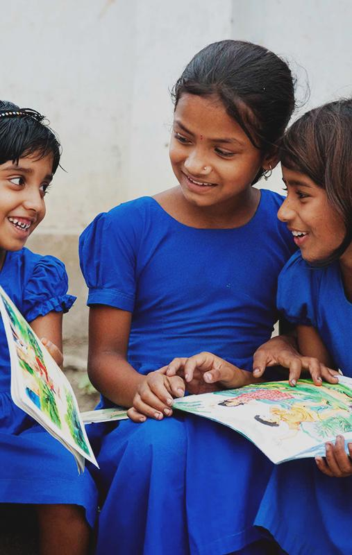 Giving back with image of girls reading