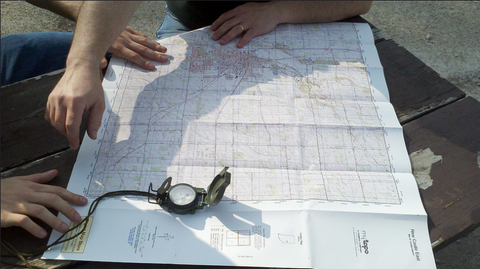Map and compass for orienteering and ten essentials