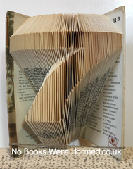 7 hand folded in to the pages of a book