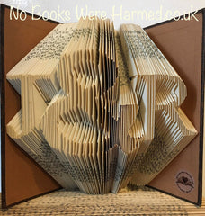 J & R hand folded in to the pages of a book