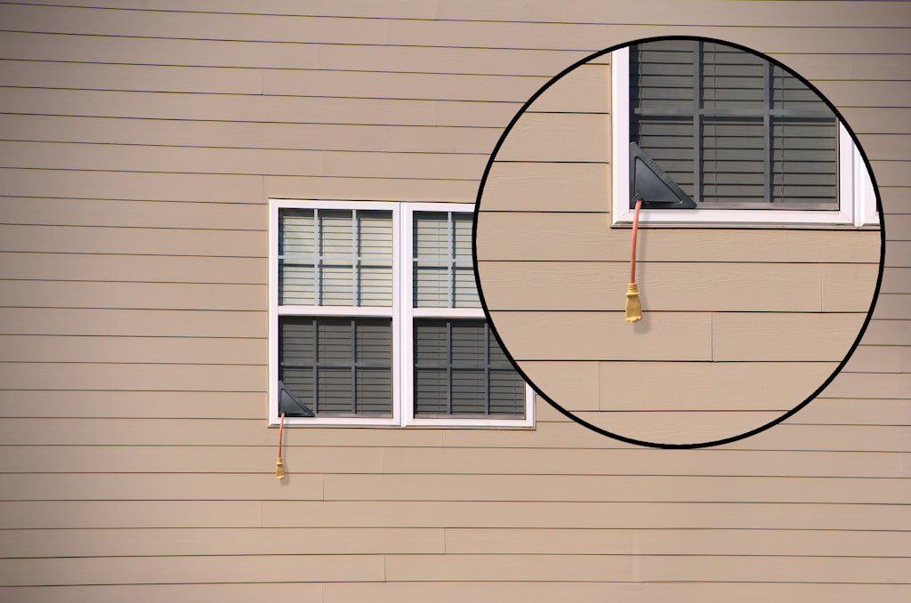 Side of a house with a window and window screen insert - ScreenLet