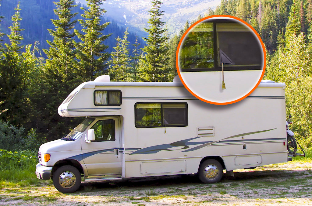 An RV in nature with a window extension cord pass through - ScreenLet