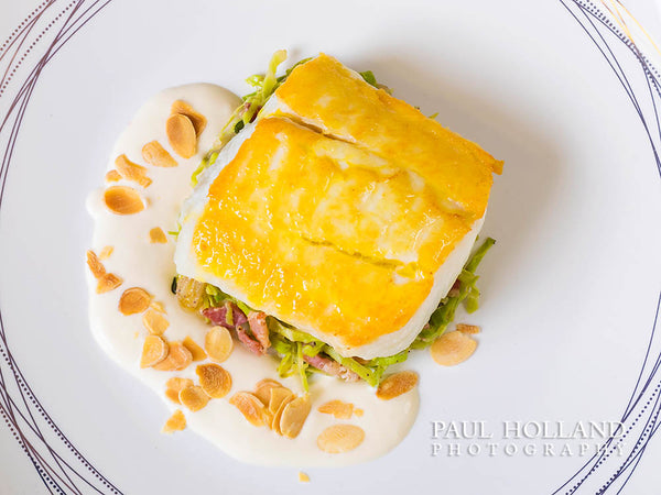 Image of a pan-fried halibut dish photographed by Paul Holland