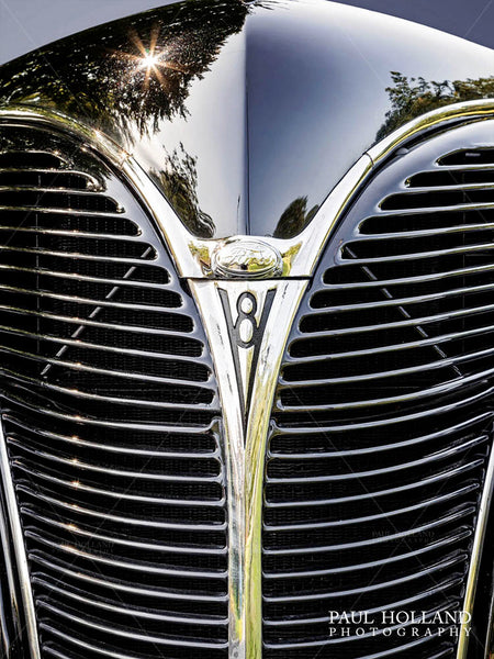 Image showing the symmetry of Ford V8 grille and bright chrome in a V shape