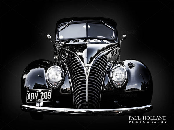 A photograph of the Ford Coupe against a black background
