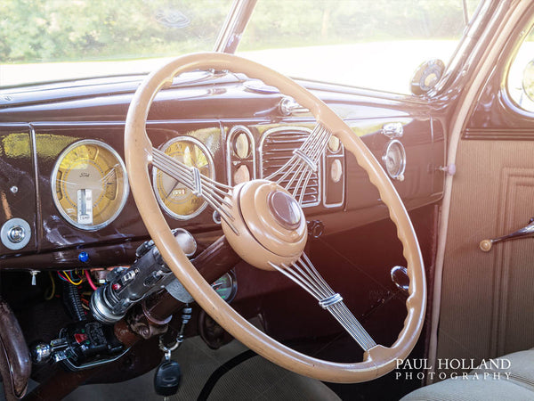 Interior of the Ford Business Coupe showing the steering wheel and dashboard