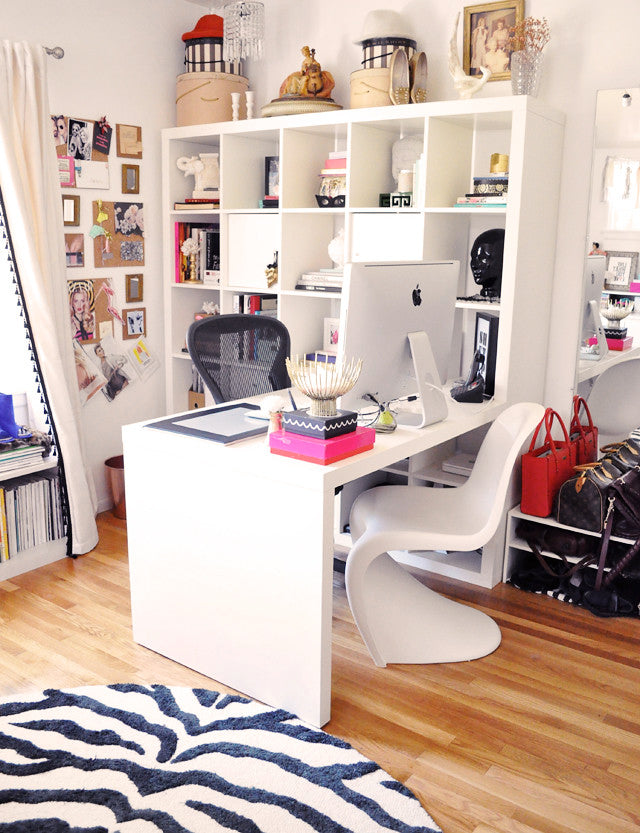 Ikea expedit  desk in home  office with zebra rug and panton chair