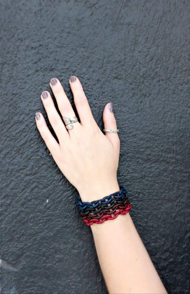 Dark and Stormy. Classic Black X Jewellery Bracelet paired with Navy, Brown and Red.