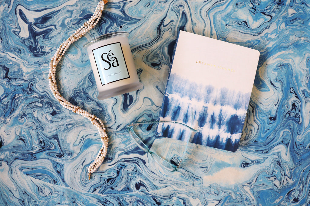 A few of a Landlocked Mermaid's favorite things: A strand of pearls, A candle that will beckon memories of your last vacation to the coast and a notebook to keep all of your best thoughts in! - Coco and Duckie
