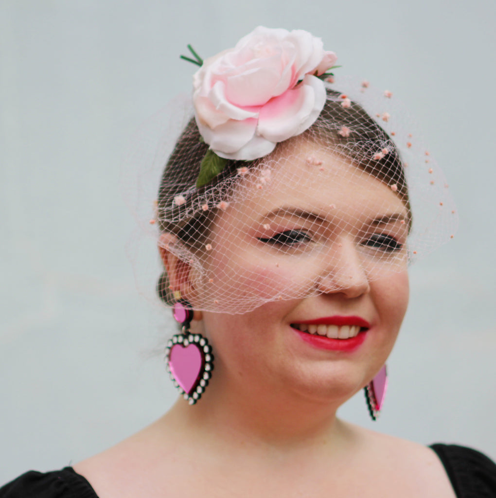 Coco is ready for Spring in a floral fascinator and our In Love Earrings by Jennifer Loiselle!