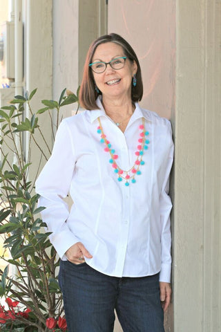 Denise wearing the Turquoise and Pink Fiesta Pom Pom Necklaces