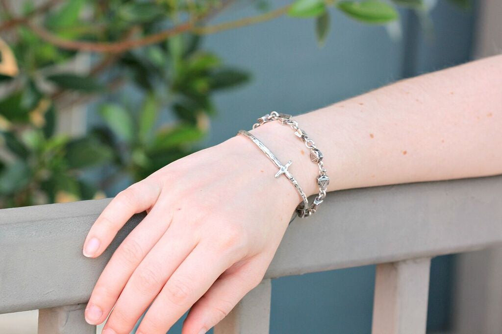 Duckie styling silver cross bangle by Visible Faith Jewelry at Coco and Duckie. #CocoAndDuckie #Jewelry #Silver #LetInTheLovely #Bangle #Bracelet #HandmadeJewelry #VisibleFaithJewelry