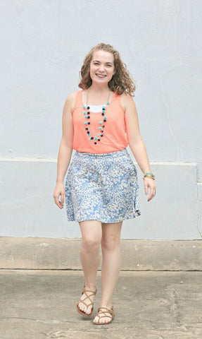 Gabby wearing the Fiesta Pom Pom Necklaces in Turquoise and Navy