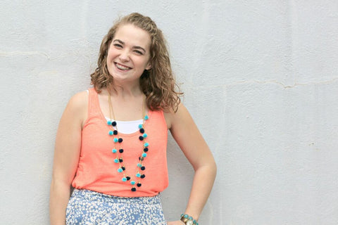 Gabby wearing the Fiesta Pom Pom Necklaces in Navy and Turquoise